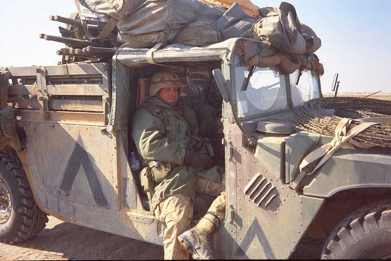 First Lt. Harry L. Whitlock in a HMMWV (Humvee) near Tallil Air Base, Iraq, March 1991. Photo courtesy of Harry L. Whitlock.