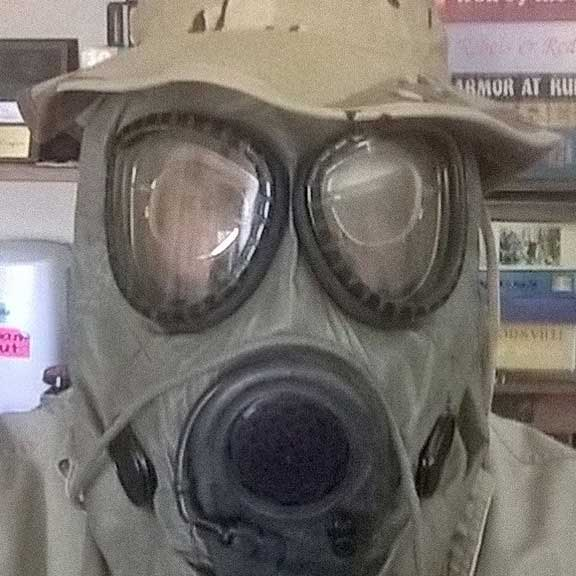 Dave Boe wears the same gas mask he wore during Desert Storm. Photo courtesy of the author.