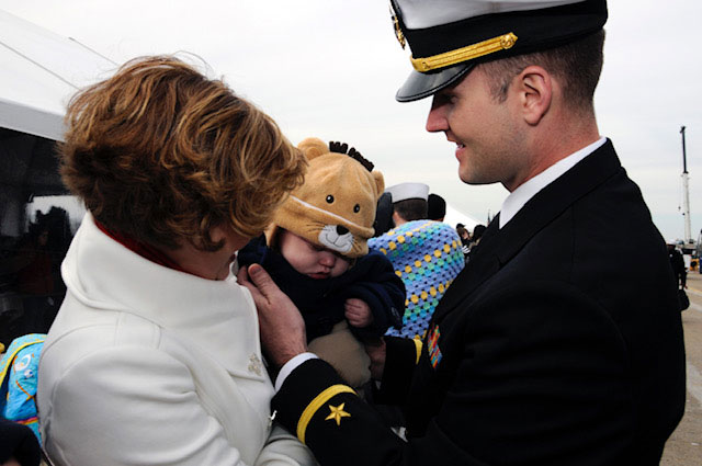 Matthew Stroup meets his six-month-old son for the first time after a seven-month tour aboard the USS George H.W. Bush. Photo courtesy of the author.