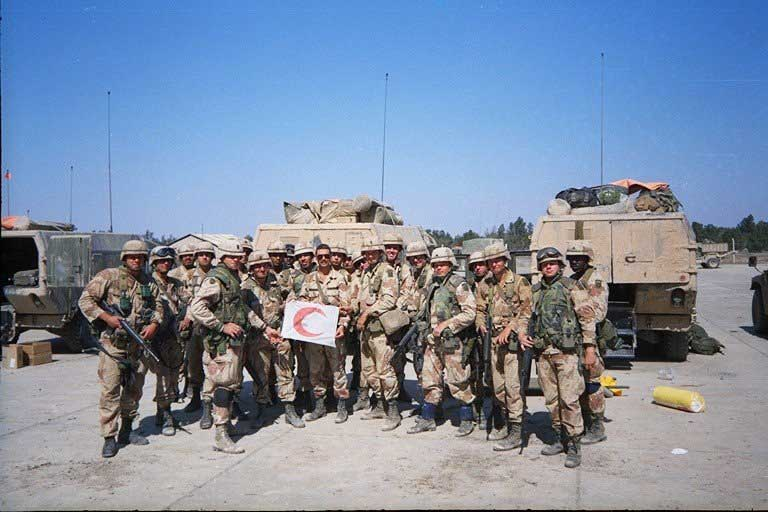 The medical platoon at Tallil Air Base, Iraq, March 1991. Chief Jeff Brasfield holds a Red Crescent flag found at the air base. Whitlock is to his left. Photo courtesy of Harry L. Whitlock.