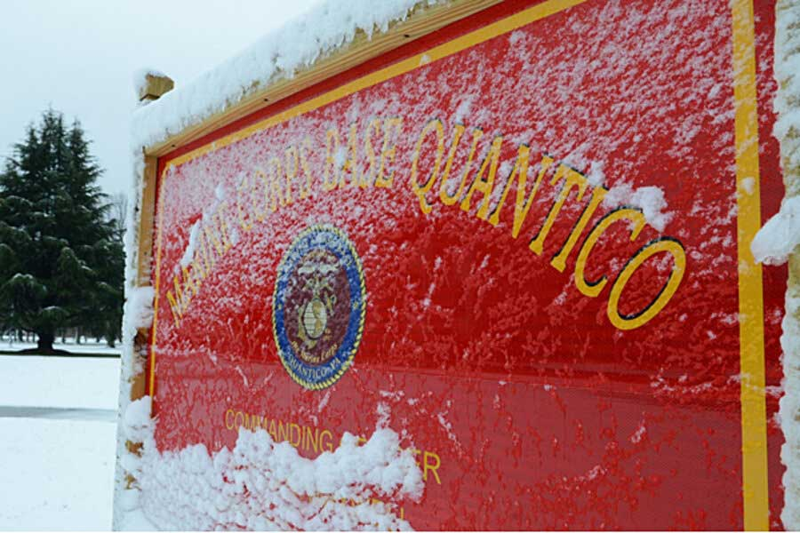 Snow covers one of many signs aboard Marine Corps Base Quantico. Photograph by LCpl. Antwaun L. Jefferson, U.S. Marine Corps.