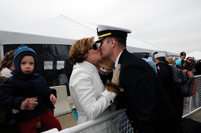 Jenny Lynne Stroup kisses her husband Matthew for the first time after he returns home from a seven-month tour aboard the USS George H.W. Bush in 2011.