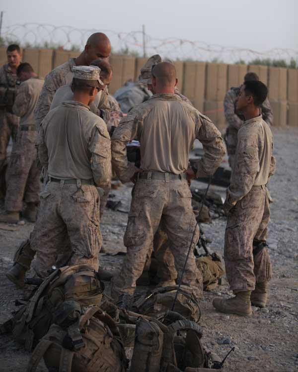 Platoon leadership briefs the team on a mission. Mikoto Yoshida, far right, listens with the other Marines. Photo courtesy of the author.