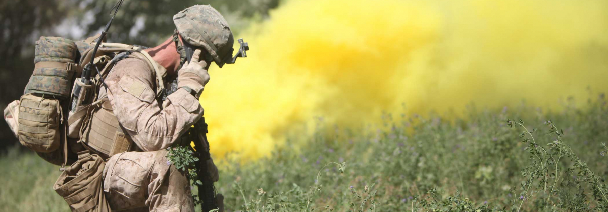 A squad leader gives a radio update behind a smoke screen. Photo courtesy of the author.