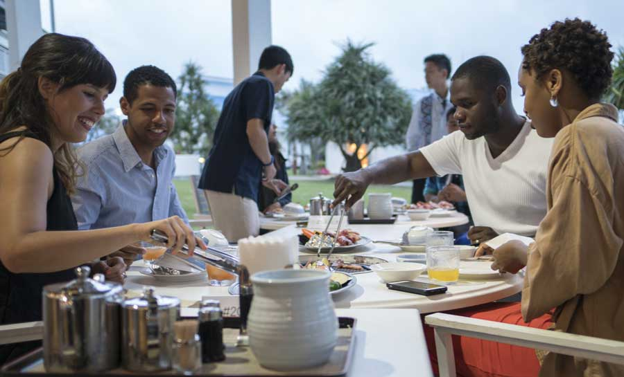 U.S. Air Force 353rd Special Operations Group Airmen and their spouses enjoy a date night during the Preservation of the Force and Families-hosted Marriage Care retreat at Ie Island, Okinawa, Japan. Photo by Capt. Jessica Tait, courtesy of U.S. Air Force.