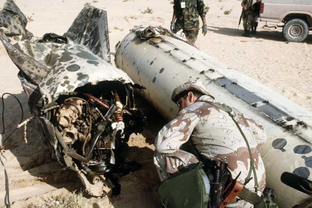 Air Force Senior Master Sgt. James Miles examines the tail section of a Scud missile shot down by a MIM-104C Patriot missile during Operation Desert Storm. Photo courtesy of U.S. Air Force.