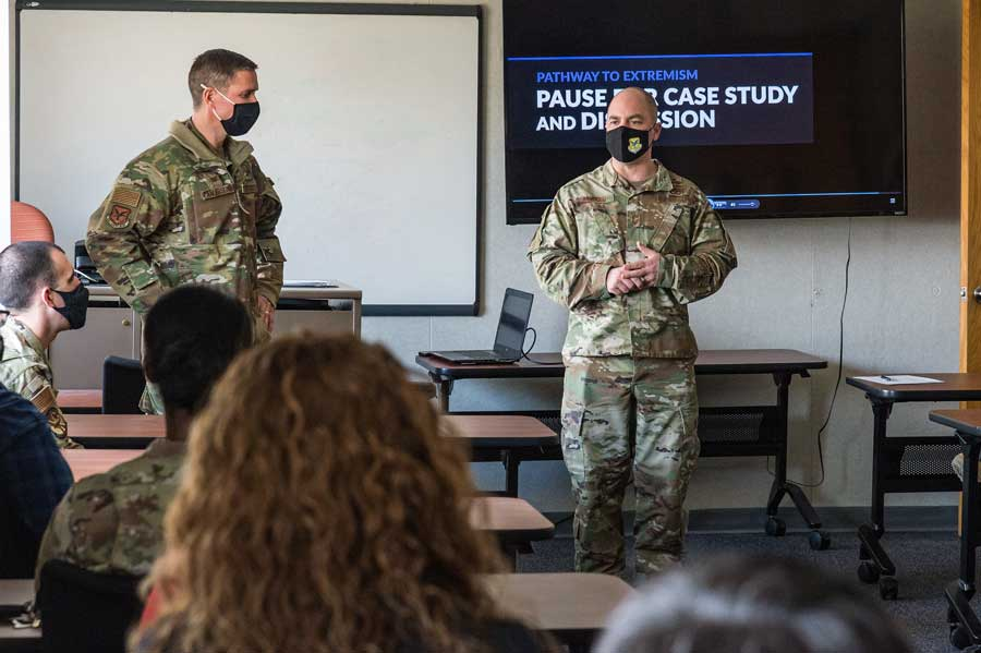 Col. Shanon Anderson, 436th Airlift Wing vice commander, left, listens to Chief Master Sgt. Jeremiah Grisham, 436th AW interim command chief, as he addresses wing staff agency members during the one-day extremism stand-down on Dover Air Force Base, Delaware, on March 19. Photo by Roland Balik, courtesy of U.S. Air Force.