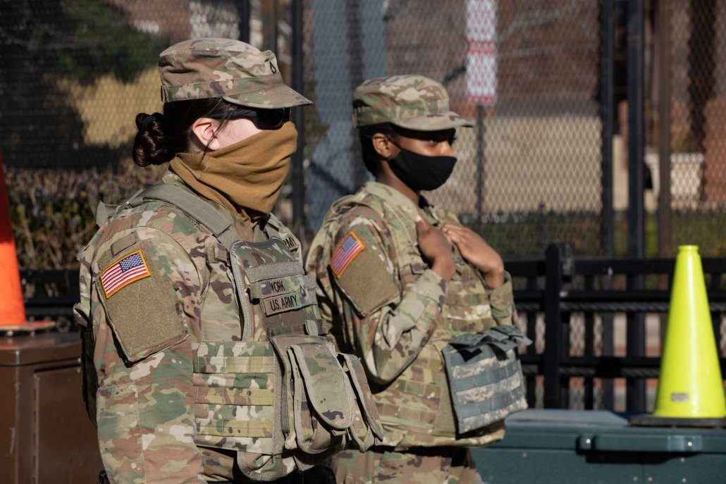 U.S. Army Pfc. Alexis York, left, and Spc. Zekia Heath, both cannon crew members with Bravo Battery, 1st Battalion 107th Field Artillery Regiment, Pennsylvania National Guard, stand watch near the U.S. Capitol in Washington, March 3, after the events of the Jan. 6 Capitol insurrection. Photo by Sgt. 1st Class R.J. Lannom Jr., courtesy of U.S. Army.