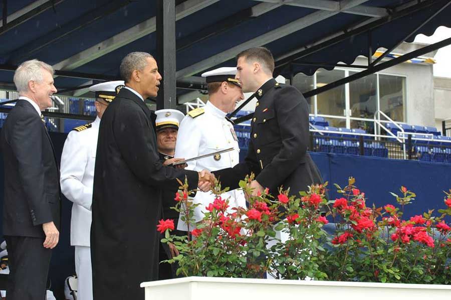 Following his commissioning ceremony, 2nd Lt. Gainey shakes the hand of then-President Barack Obama. Photograph courtesy of Paul Gainey.