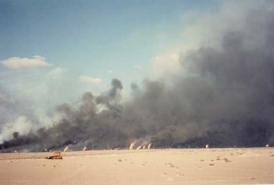 Oil fires darken the sky during the 1991 Persian Gulf War. Photo courtesy of Anthony Hardie.