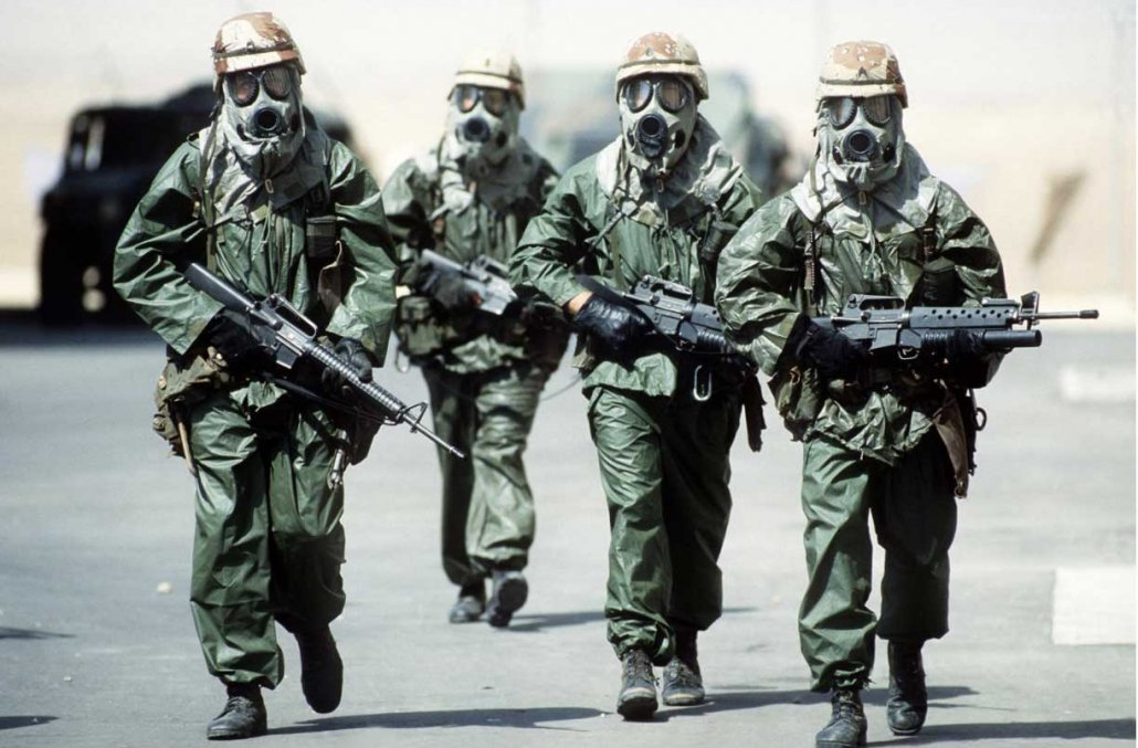 Troops from the 82nd Airborne Division wear chemical protective gear to acclimate to the heat during Operation Desert Shield. Photo by Sgt. F Lee Corkran, courtesy of U.S. Air Force.