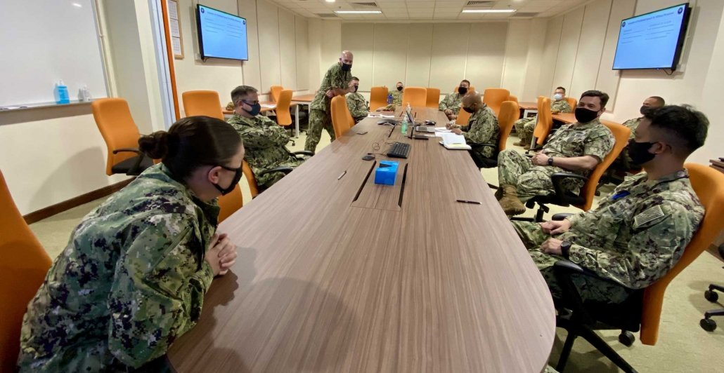 While deployed near Singapore, sailors assigned to Commander Destroyer Squadron Seven participate in a Navy-wide stand-down to address extremism in the ranks on March 12. Photo by Lt. Lauren Chatmas, courtesy of U.S. Navy.