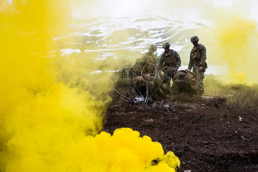 Marines deploy a smoke grenade to obscure movements from opposing forces. US Marine Corps/Lance Cpl. Chase Drayer