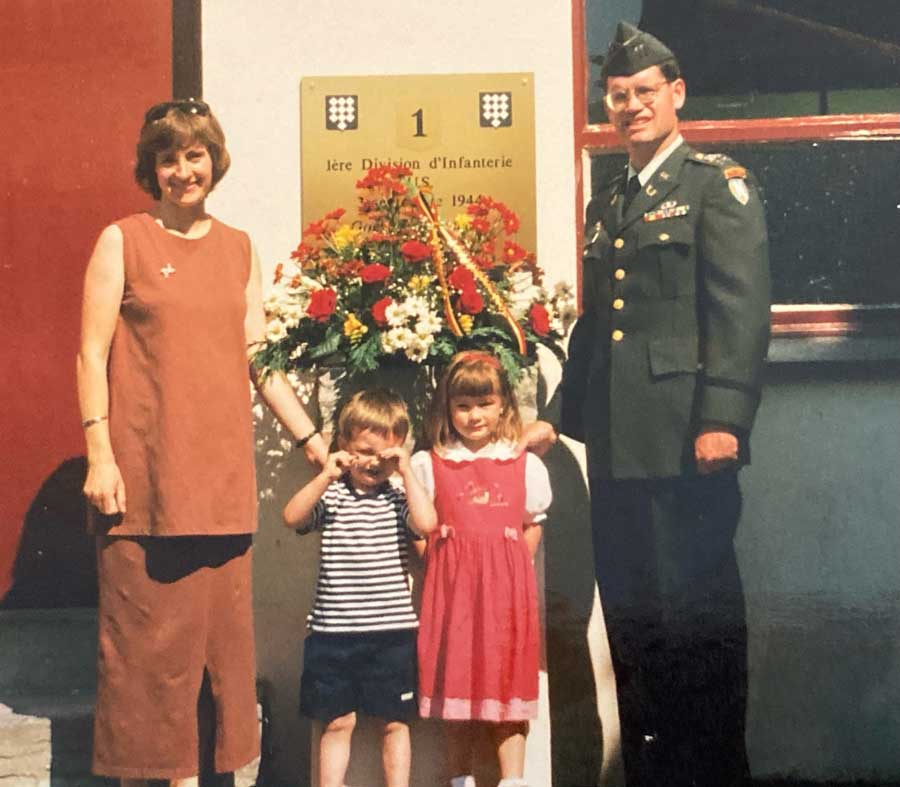 A Military Child Learns What It Means to Be an American. By Leaving - The author, third from right, with her family in Quévy, Belgium, on the anniversary of the area's liberation from the Germans by the Allies in 1944.