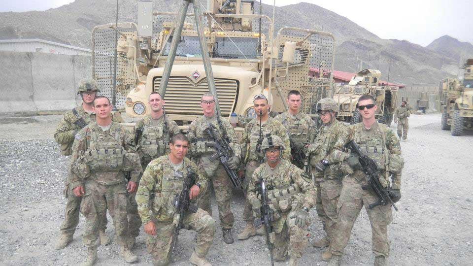 Corbin Chesley, back row, far left, poses with his squad in Afghanistan. Photo courtesy of author.