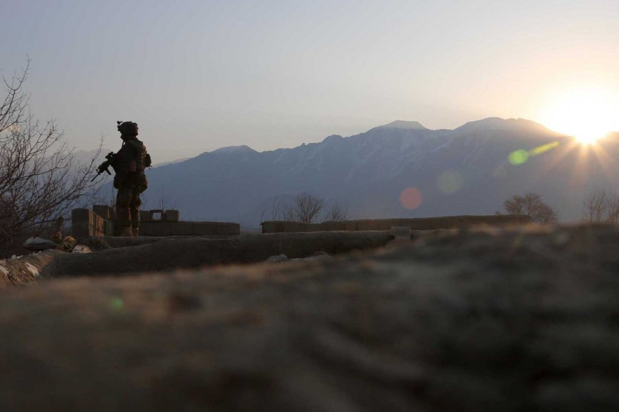 An Afghan National Army commando with the 6th Special Operations Kandak guards a rooftop during morning operations in Tagab District, Kapisa Province, Afghanistan, in February 2013. Photo by Pfc. James K. McCann, courtesy of U.S. Army.
