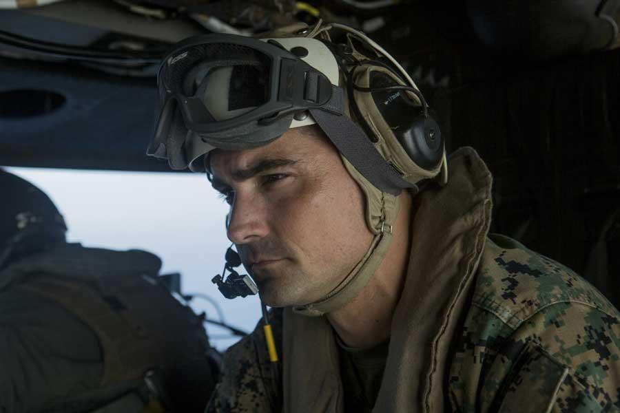 Lt. Col. Francisco Zavala looks out over the Pacific Ocean as he flies in a UH-1Y Venom, Nov. 17, 2018. US Marine Corps/Cpl. Joseph Prado