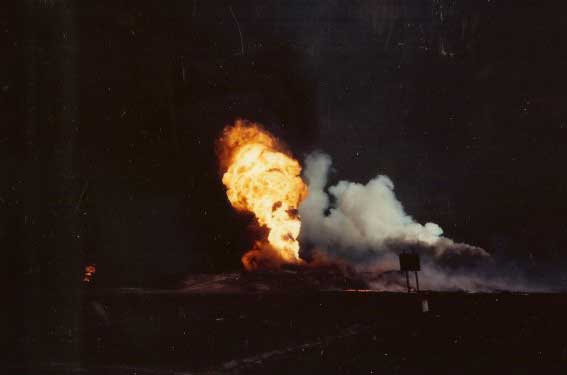 An oil fire roars during the 1991 Persian Gulf War. Photo courtesy of Anthony Hardie.