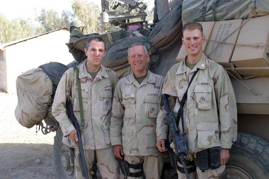 Joe Plenzler (left) stands beside his commanding officer, then-Major Gen. James Mattis (center) and Capt. Warren Cook, near Ad Diwaniyah, Iraq, in 2003. Photograph courtesy of Joe Plenzler.