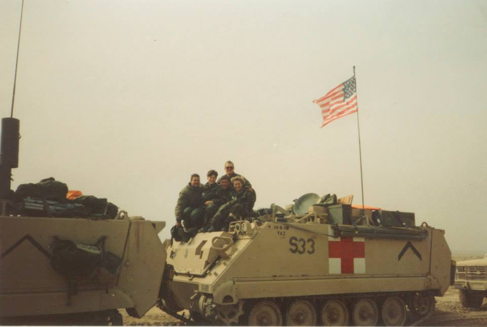 Angela Menard poses with a team of medics as they prepare to return home after Operation Desert Storm. Photo courtesy of Angela Menard.