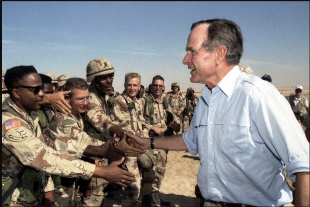 President George H.W. Bush meets with troops in Saudi Arabia on Thanksgiving during the Gulf War, Nov. 22, 1990. Photo courtesy of George Bush Presidential Library and Museum.