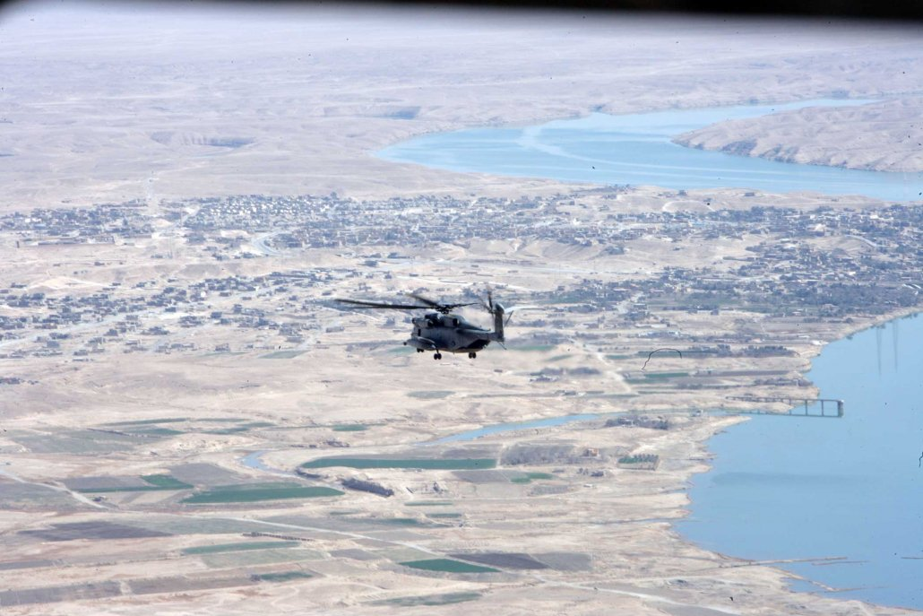 A CH-53 Super Stallion from Marine Heavy Helicopter Squadron-361 flies up the bank of the Euphrates River in Iraq in 2008. Photo by Cpl. Justinn McElderry, courtesy of U.S. Marine Corps.