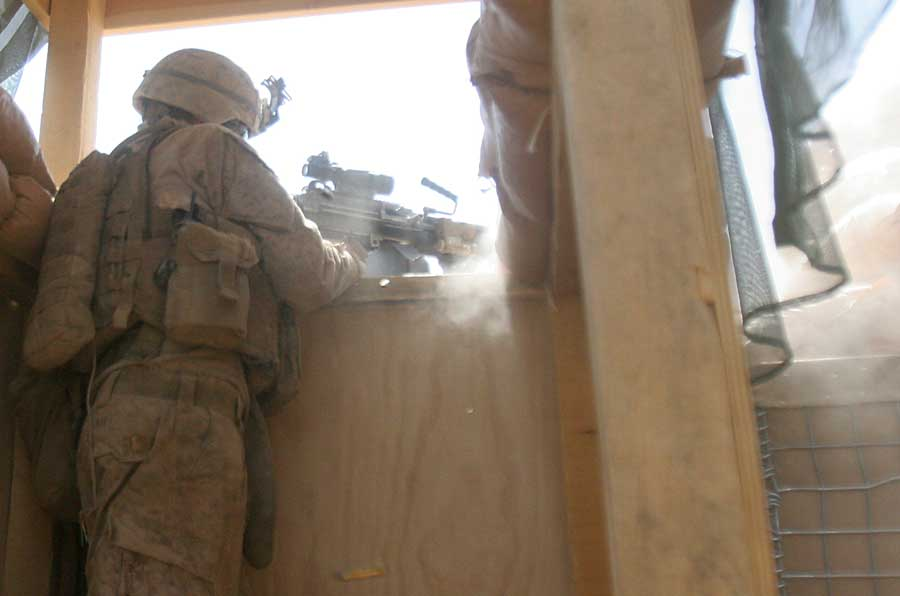 A Marine from 3rd Battalion, 4th Marines, fires an M249 squad automatic weapon at the enemy during a firefight July 24, 2011, at Observation Post Kakar, Afghanistan. Photo by Staff Sgt. Ryan Smith, courtesy of U.S. Marine Corps.
