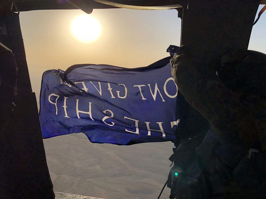 The U.S. Naval Academy flag flying over Kandahar from a Black Hawk in 2018. Photo courtesy of the author.