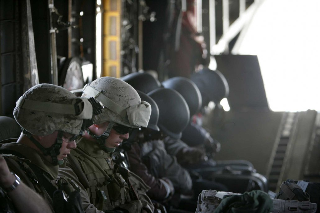 Marines, soldiers, sailors, and civilian workers wait for takeoff aboard a CH-53 Super Stallion in Al Anbar province, Iraq, in 2008. Photo by Cpl. Justinn McElderry, courtesy of U.S. Marine Corps.