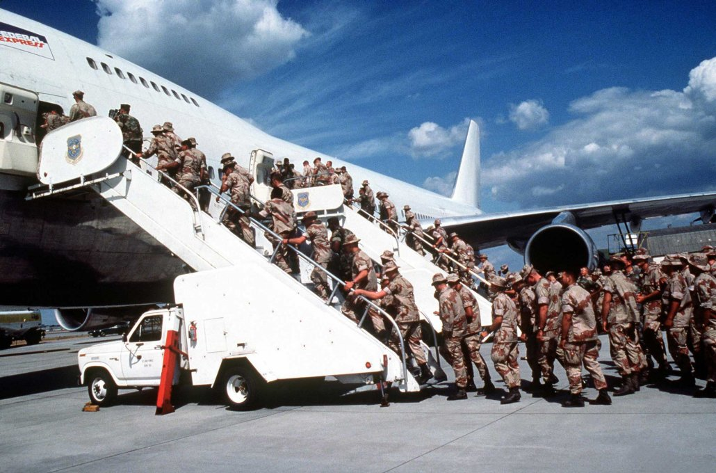 Marines headed to support the coalition forces participating in Operation Desert Shield board a commercial aircraft chartered by the Military Airlift Command in September 1991. Photo courtesy of the Defense Department.