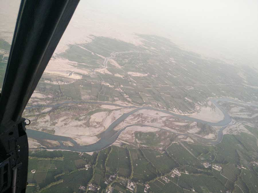 Crossing the Helmand River—enemy-held territory—with the aircraft doors off in 2018. Photo courtesy of the author.