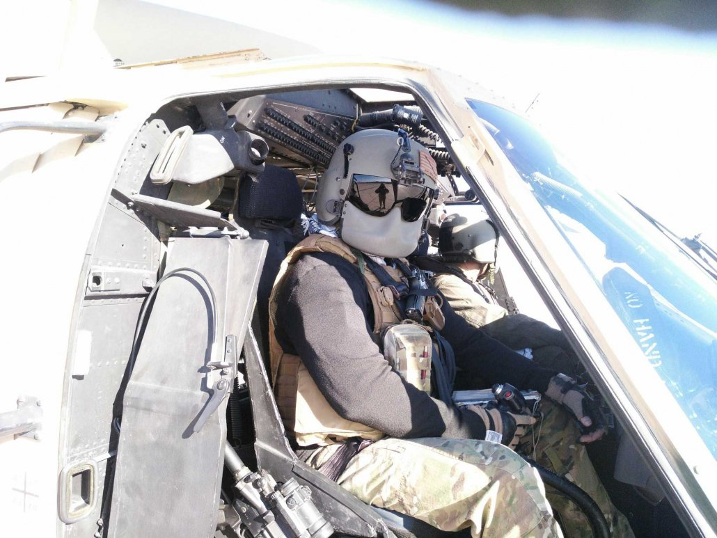 Jack McCain poses for an Afghan crew chief before a teaching flight. Photo courtesy of the author.