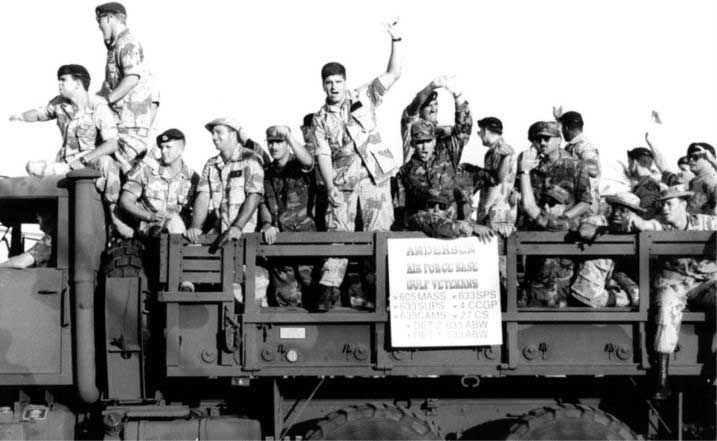 Airmen from the 633rd Air Base Wing and other tenant units wave to the crowd during a victory parade for Operation Desert Storm at Andersen Air Force Base, Guam, In April 1991. Photo courtesy of U.S. Air Force.