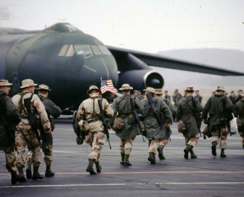 Soldiers deploying to the Gulf War make their way to a plane in 1990 at Volk Field, Wisconsin, on Jan. 1, 1991. Photo courtesy of U.S. Army.
