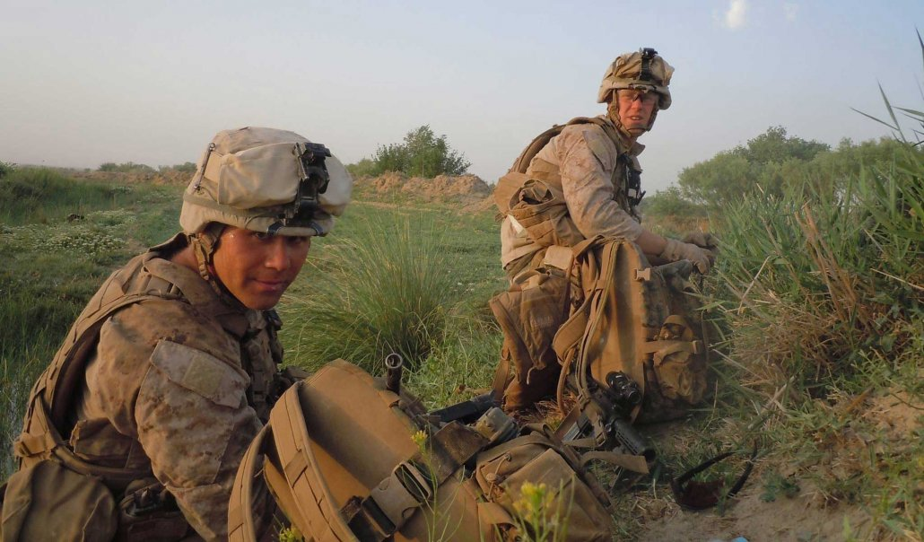 The Author and another Marine prepare to set up a guardian angel position on patrol near Kakar, Helmand. Photo by Stephen Danz Lopez, courtesy of the author.