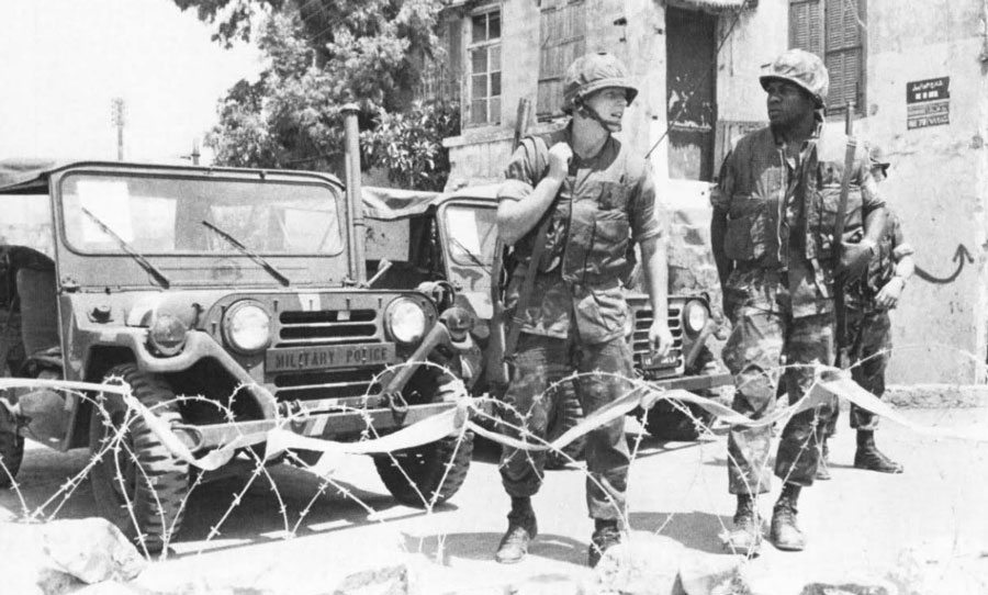 32nd Marine Amphibious Unit Marines remain alert while manning a checkpoint during their supervision of the evacuation of the PLO from the port of Beirut in late August 1982 . Photo by Photographer's Mate Petty Officer 3rd Class R.P. Fitzgerald, courtesy of U.S. Navy.