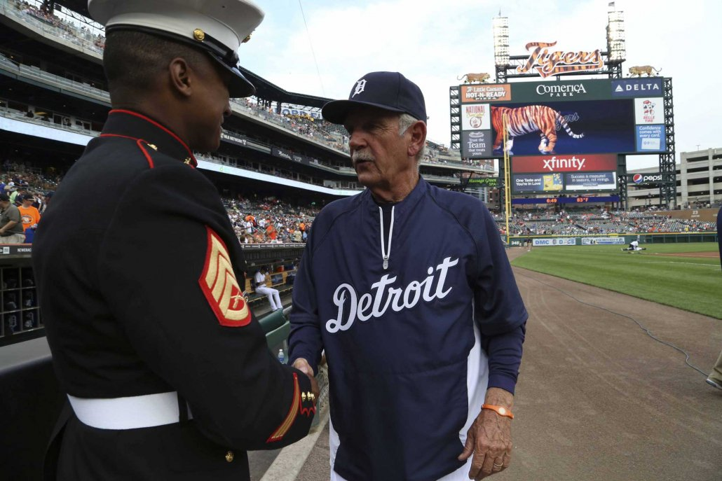 Staff Sgt. Michael Milliner meets Jim Leyland, Detroit Tigers manager, at Comerica Park in 2013. Comerica manages a debit card program for the government that has been accused of fraud. Photo by Sgt. Elyssa Quesada, courtesy of the U.S. Marine Corps.