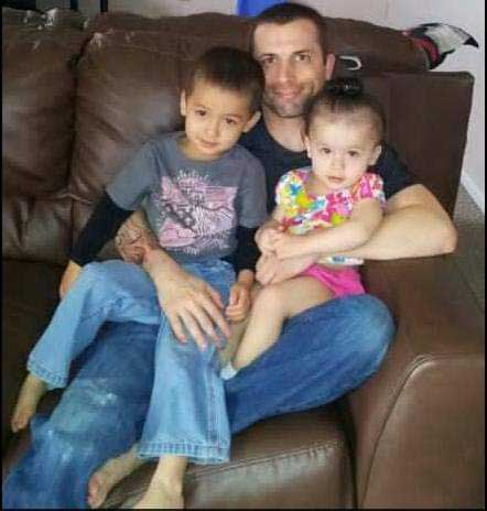 d Adams holds his two children, T.J. and Chloe. Photo courtesy of the author.
