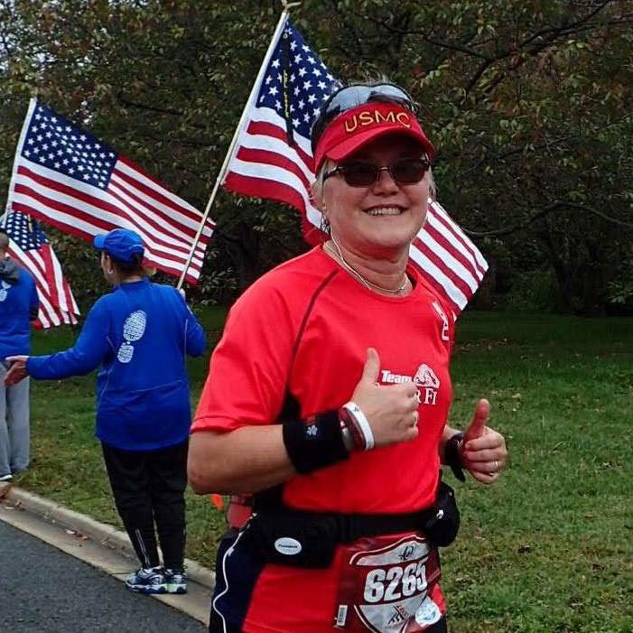 After coming out, the author trained for and ran the 2015 40th Marine Corps Marathon to celebrate her 60th birthday. Photo by Annie Sutherland, courtesy of the author.