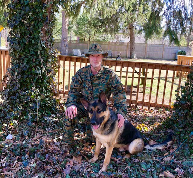 Derek Densmore poses with his dog Bruno. Having money stolen from his Direct Express account affected the retired Marine's sense of security. Photo courtesy of Jackie Densmore.