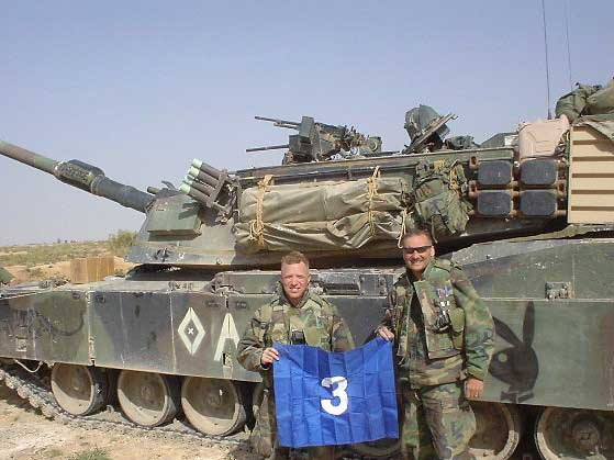 """Reed Bonadonna stands in front of a tank in Iraq with his friend, Maj. """"Hawk"""" Hawkins, forward air controller of A Company, 8th Tank Battalion. Photo courtesy of the author."""