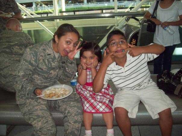 The author plays with her niece and nephew at Baltimore/Washington International Thurgood Marshall Airport the day the author deployed in 2009. Photo courtesy of the author.