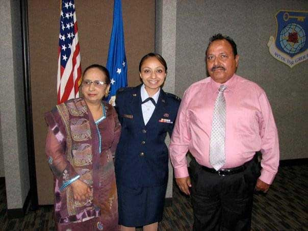 The author poses with her mom and dad after she was promoted to captain at Joint Base Langley Eustis in 2010. Photo courtesy of the author.