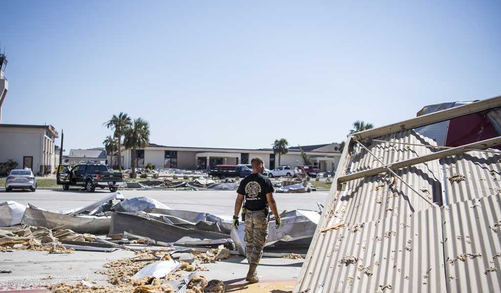 A member of the 325th Civil Engineer Squadron begins the clean-up process around their squadron on Tyndall Air Force Base, Florida, in 2018, following Hurricane Michael. Multiple major commands have mobilized to help after the hurricane caused catastrophic damage to the base. Photo by Senior Airman Keifer Bowes, courtesy U.S. Air Force.