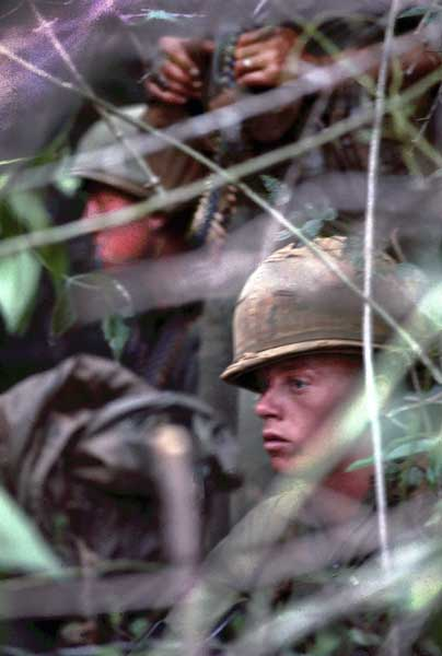 Soldiers with C Co. 1/12th Cavalry Regiment hide in the thicket as they wait for an after-dark ambush. Photo courtesy of the author.
