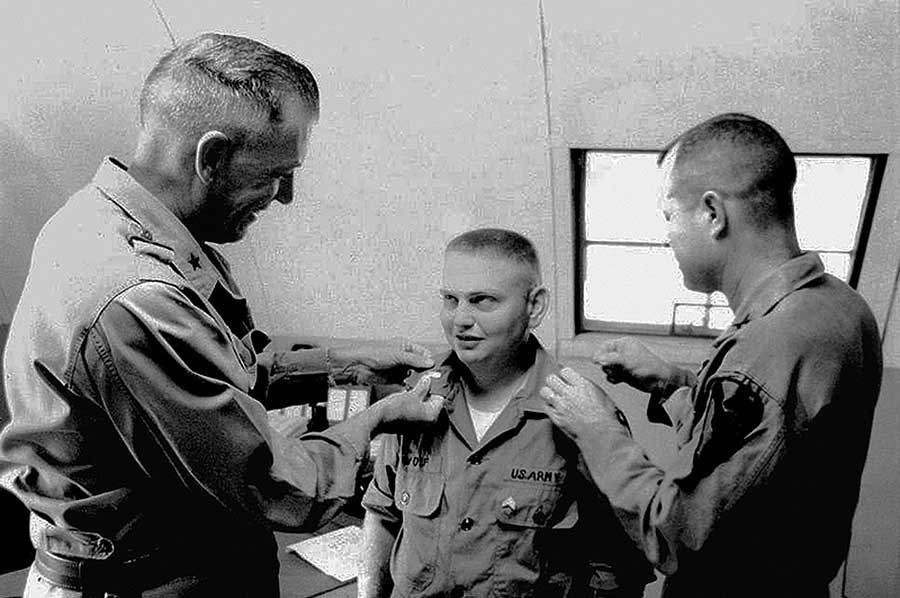 Second Lt. Marvin J. Wolf, center, receives his commission at 1st Cavalry headquarters at An Khe in Vietnam, from Brigadier General Richard Becker and Major John Phillips. Photo courtesy of the U.S. Army.