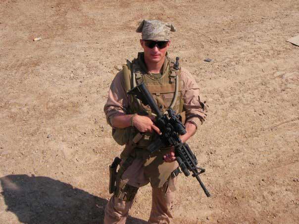 Brett Foley prepares for patrol in Iraq. Photo courtesy of the author.