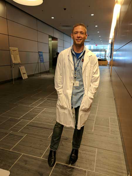 The author wears his lab coat for the first time after completing his engineering degree in September 2017. Photo courtesy of the author.