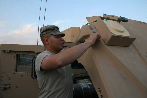 Tom Smoot upgrades HMMWV GPS transceivers in Iraq's Diyala Province in December 2006. Photo courtesy of the author.