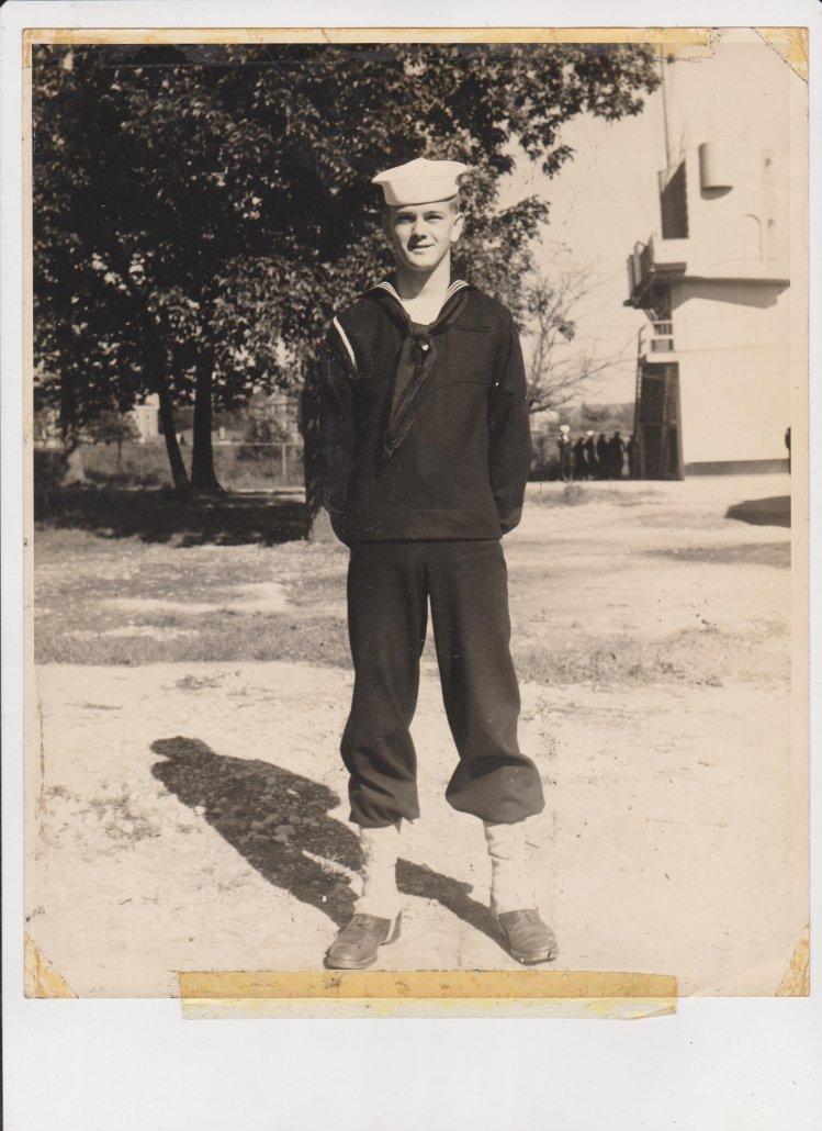 James Jerry Ryals, in his late teens, poses in his Navy uniform. When he tried on his uniform again after he was out of the Navy, his skin broke out in blisters.